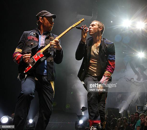 Jonny Buckland and Chris Martin perform live with their band Coldplay at the Ahoy on October 2 2008 in Rotterdam Netherlands