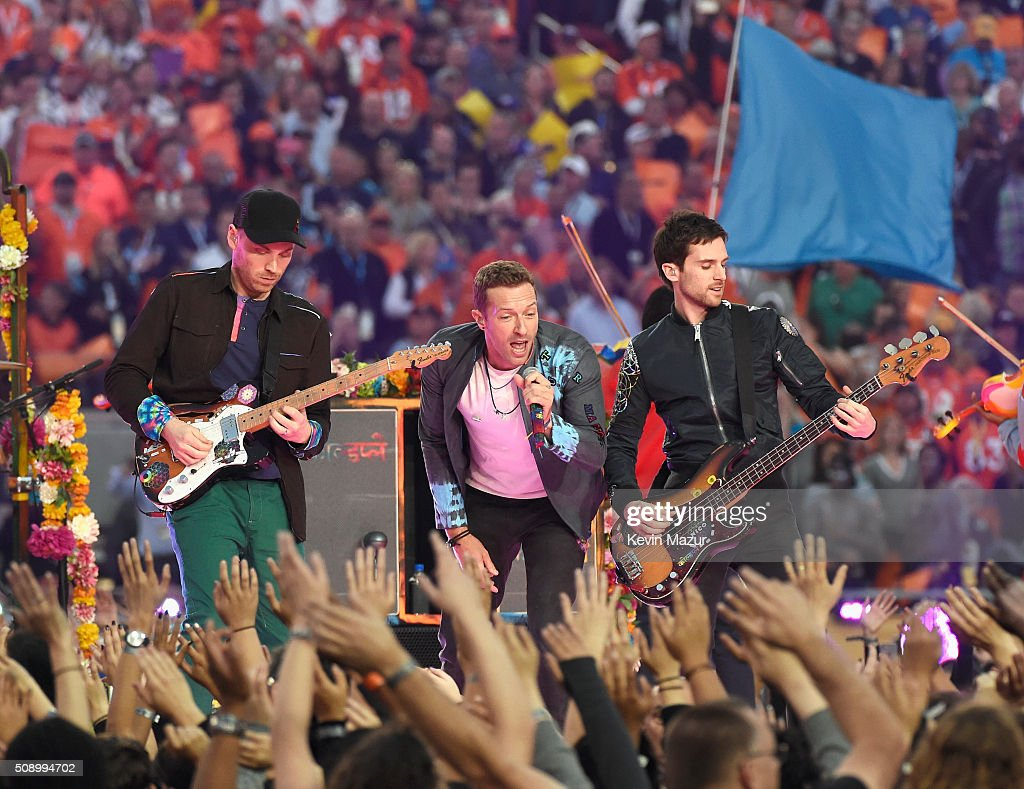 Jonny Buckland, Chris Maritn and Guy Berryman of Coldplay perform onstage during the Pepsi Super Bowl 50 Halftime Show at Levi's Stadium on February 7, 2016 in Santa Clara, California.