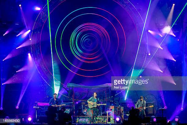 Jonny Buckland Chris Martin and Guy Berryman of Coldplay perform on stage at Emirates Stadium on June 1 2012 in London United Kingdom
