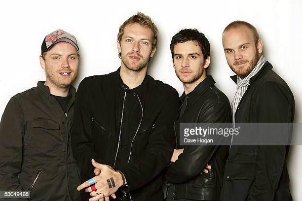 Jonny Buckland Chris Martin Guy Berryman and Will Champion of Coldplay pose at a studio session to promote the band's new album 'XY' at the W Hotel...