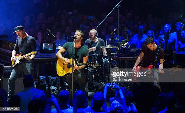 Jonny Buckland Chris Martin Will Champion and Guy Berryman of Coldplay perform at Royal Albert Hall on July 2 2014 in London England