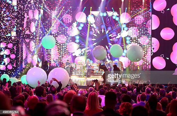 Jonny Buckland Chris Martin Will Champion and Guy Berryman of Coldplay perform onstage at the 2015 American Music Awards at Microsoft Theater on...