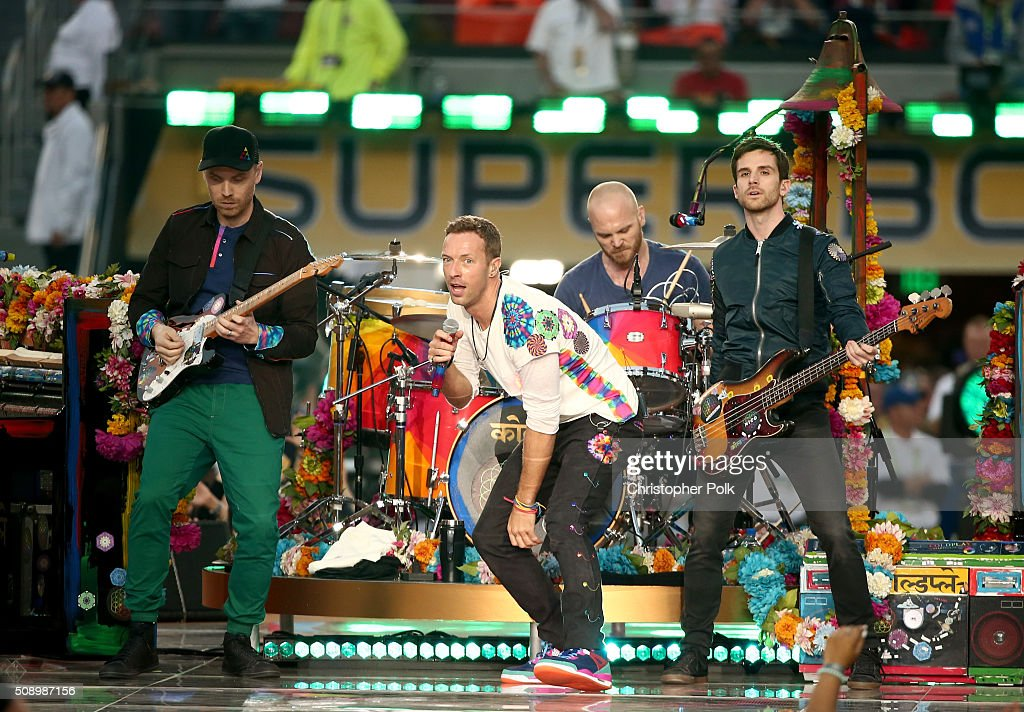 Jonny Buckland, Chris Martin, Will Champion and Guy Berryman of Coldplay perform onstage during the Pepsi Super Bowl 50 Halftime Show at Levi's Stadium on February 7, 2016 in Santa Clara, California.