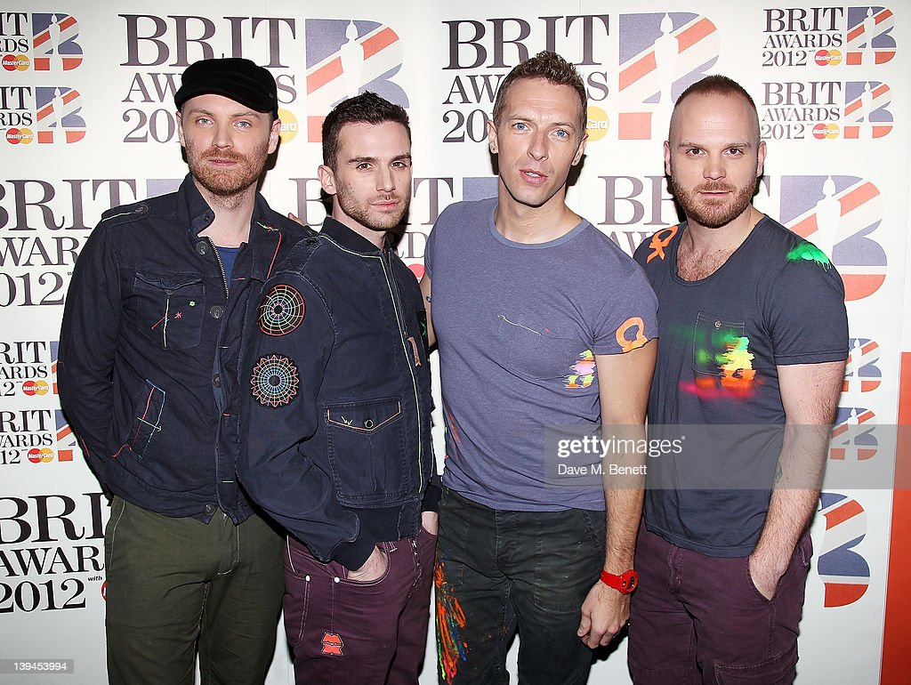 Jonny Buckland, Guy Berryman, Chris Martin and Will Champion of Coldplay arrive at the BRIT Awards 2012 at O2 Arena on February 21, 2012 in London, England.