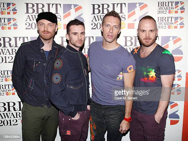 Jonny Buckland Guy Berryman Chris Martin and Will Champion of Coldplay arrive at the BRIT Awards 2012 at O2 Arena on February 21 2012 in London...