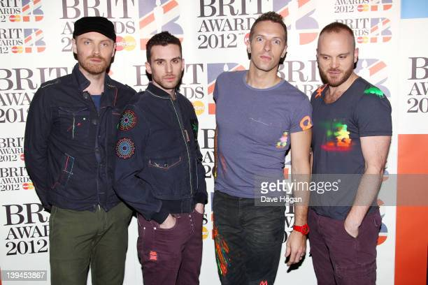 Jonny Buckland Guy Berryman Chris Martin and Will Champion of Coldplay attend The Brit Awards 2012 at The O2 Arena on February 21 2012 in London...