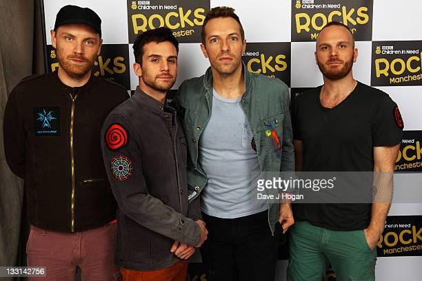 Jonny Buckland Guy Berryman Chris Martin and Will Champion of Coldplay pose backstage at Children In Need Rocks Manchester 2011 at The Manchester...