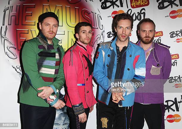 Jonny Buckland Guy Berryman Chris Martin and Will Champion of Coldplay pose backstage during the Brit Awards 2009 at Earls Court on February 18 2009...