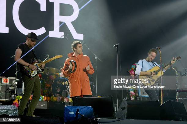 Jonny Buckland Liam Gallagher and Chris Martin perform on stage during the One Love Manchester Benefit Concert at Old Trafford Cricket Ground on June...