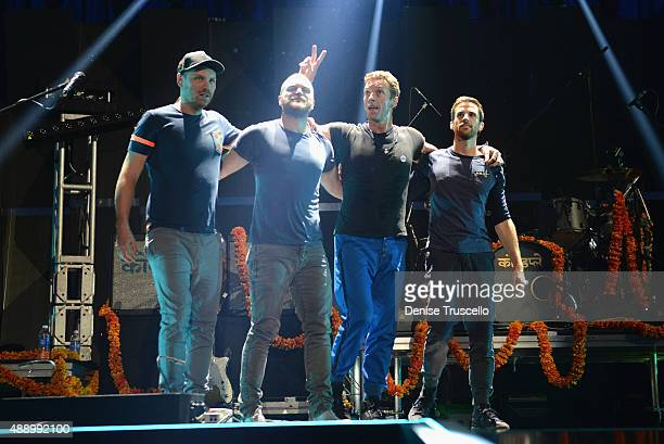 Jonny Buckland Will Chamption Chris Martin and Guy Berryman of Coldplay perform onstage at the 2015 iHeartRadio Music Festival at MGM Grand Garden...