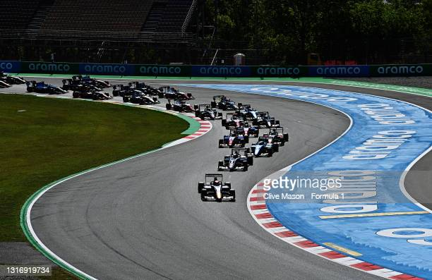 Jonny Edgar of Great Britain and Carlin Buzz Racing drives leads the field round turn one at the start during race 1 of Round 1:Barcelona of the...