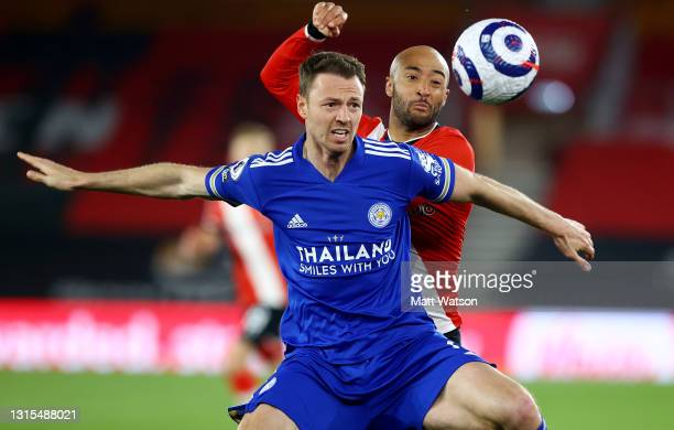 Jonny Evans of Leicester and Nathan Redmond of Southampton during the Premier League match between Southampton and Leicester City at St Mary's...