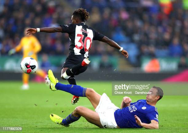 Jonny Evans of Leicester City and Christian Atsu of Newcastle United in action during the Premier League match between Leicester City and Newcastle...