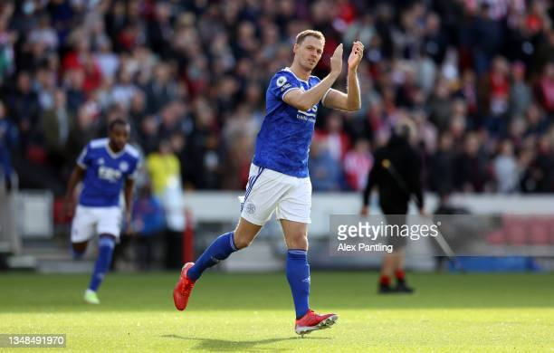 Jonny Evans of Leicester City applauds the fans as he enters the pitch prior to the Premier League match between Brentford and Leicester City at...