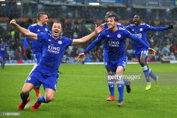 Jonny Evans of Leicester City celebrates his sides third goal with Ben Chilwell of Leicester City during the Premier League match between Burnley FC...