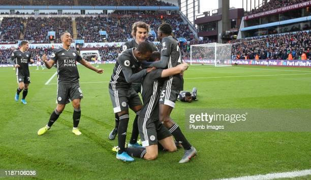 Jonny Evans of Leicester City celebrates with Caglar Soyuncu of Leicester City, Ricardo Pereira of Leicester City, Wilfred Ndidi of Leicester City...