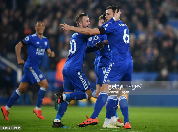 Jonny Evans of Leicester City celebrates with teammates after scoring his team's first goal during the Premier League match between Leicester City...