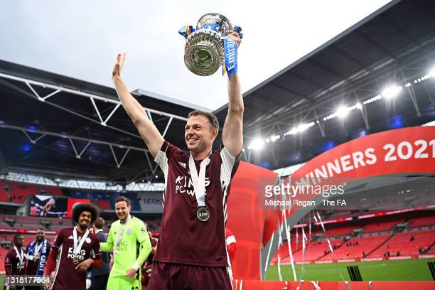 Jonny Evans of Leicester City celebrates with the Emirates FA Cup trophy following The Emirates FA Cup Final match between Chelsea and Leicester City...