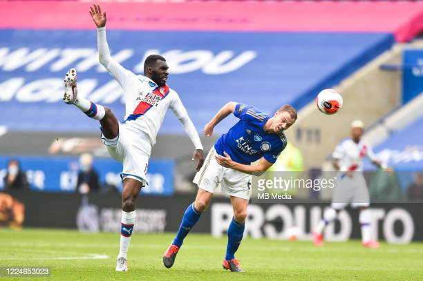 Jonny Evans of Leicester City heads clear from Christian Benteke of Crystal Palace during the Premier League match between Leicester City and Crystal...