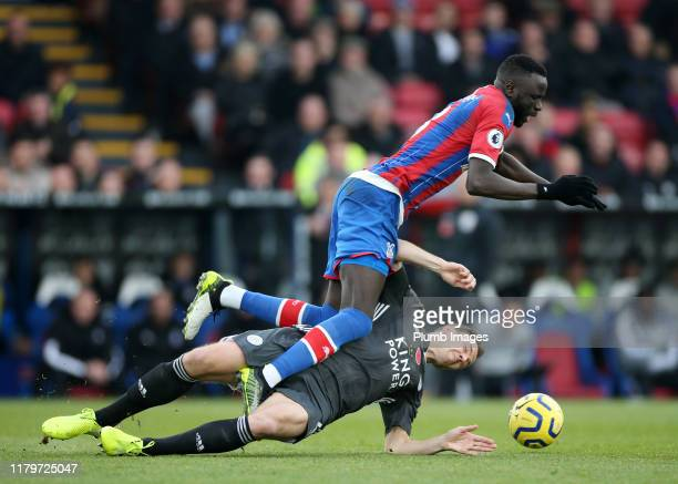Jonny Evans of Leicester City in action with Cheikhou Kouyaté of Crystal Palace during the Premier League match between Crystal Palace and Leicester...