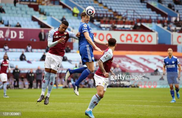 Jonny Evans of Leicester City in action with Ezri Konsa of Aston Villa during the Premier League match between Aston Villa and Leicester City at...