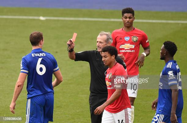 Jonny Evans of Leicester City is shown a red card during the Premier League match between Leicester City and Manchester United at The King Power...