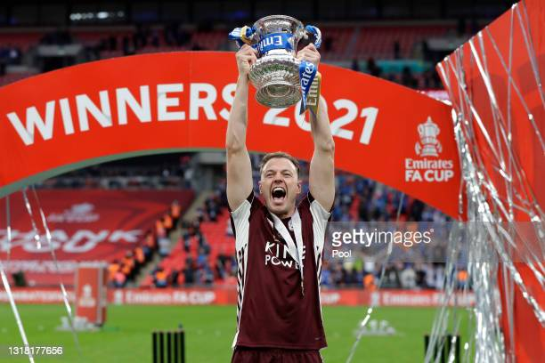 Jonny Evans of Leicester City lifts the Emirates FA Cup Trophy following The Emirates FA Cup Final match between Chelsea and Leicester City at...