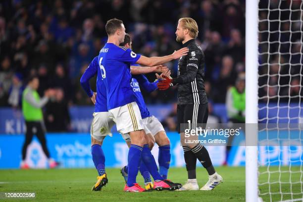 Jonny Evans of Leicester City reacts to the save made by Kasper Schmeichel of Leicester City during the Premier League match between Leicester City...