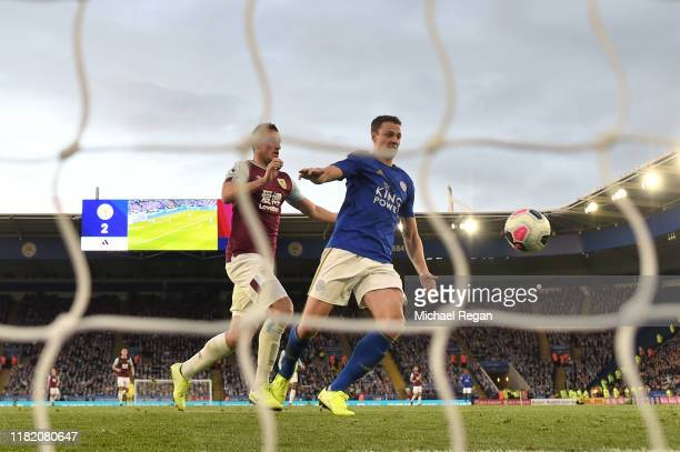 Jonny Evans of Leicester City scores an own goal for Burnley's second goal which is then disallowed by VAR for a trip by Chris Wood of Burnley during...