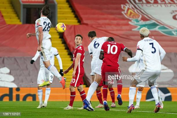 Jonny Evans of Leicester City scores an own goal to make it the first goal for Liverpool during the Premier League match between Liverpool and...