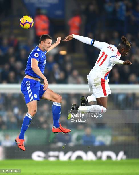 Jonny Evans of Leicester City wins a header as he battles for possession with with Wilfried Zaha of Crystal Palace during the Premier League match...