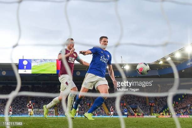 Jonny Evans of Leicester scores an own goal which is later disallowed for a foul by Chris Wood of Burnley during the Premier League match between...