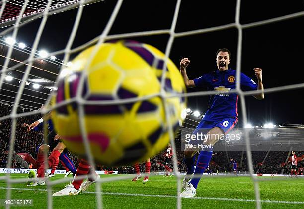 Jonny Evans of Manchester United celebrates Robin van Persie's second goal during the Barclays Premier League match between Southampton and...