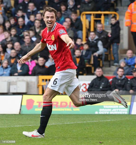 Jonny Evans of Manchester United celebrates scoring their first goal during the Barclays Premier League match between Wolverhampton Wanderers and...