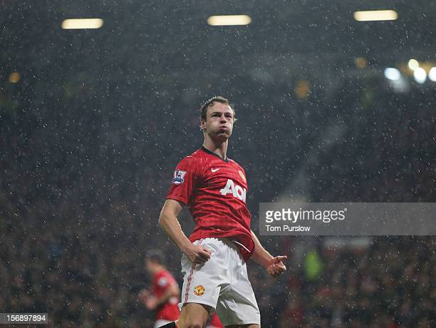 Jonny Evans of Manchester United celebrates scoring their first goal during the Barclays Premier League match between Manchester United and Queens...