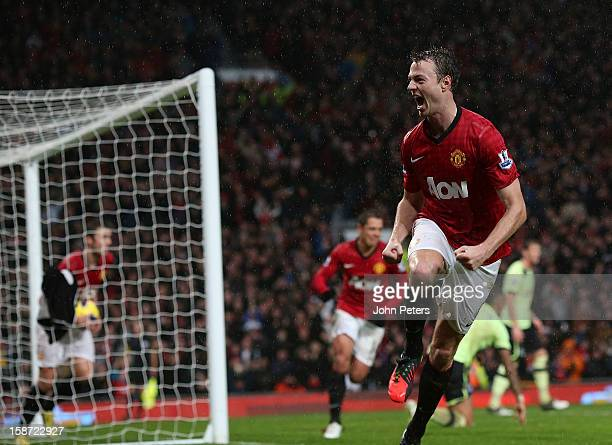 Jonny Evans of Manchester United celebrates scoring their first goal during the Barclays Premier League match between Manchester United and Newcastle...