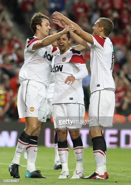 Jonny Evans of Manchester United celebrates scoring their sixth goal with Javier Chicharito Hernandez and Nemanja Vidic during the preseason friendly...