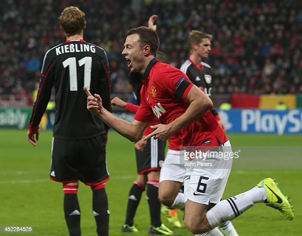 Jonny Evans of Manchester United celebrates scoring their third goal during the UEFA Champions League Group A match between Bayer Leverkusen and...