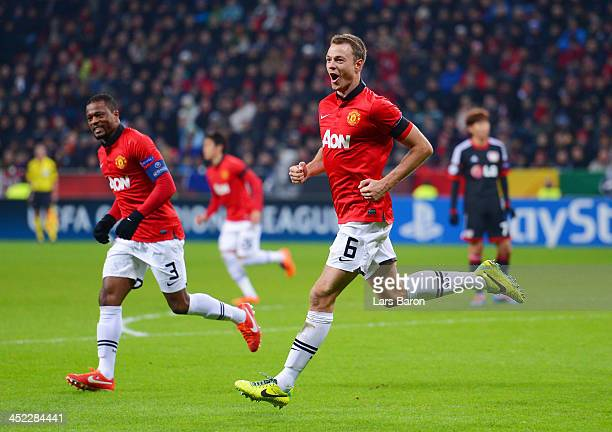 Jonny Evans of Manchester United celebrates with Patrice Evra of Manchester United after scoring their third goal during the UEFA Champions League...