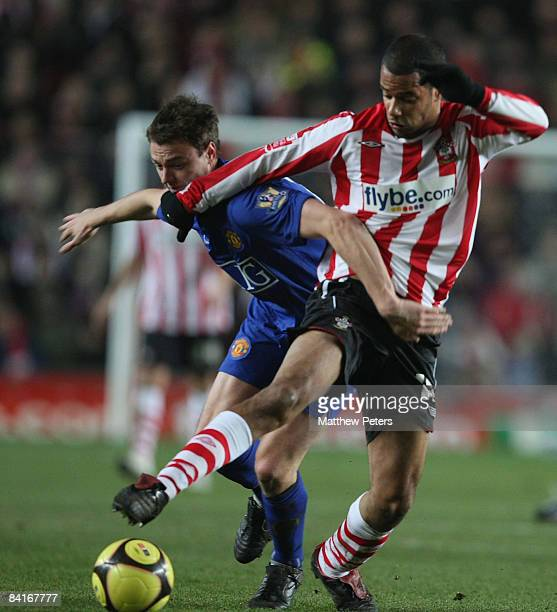 Jonny Evans of Manchester United clashes with David McGoldrick of Southampton during the FA Cup sponsored by eon Third Round match between...