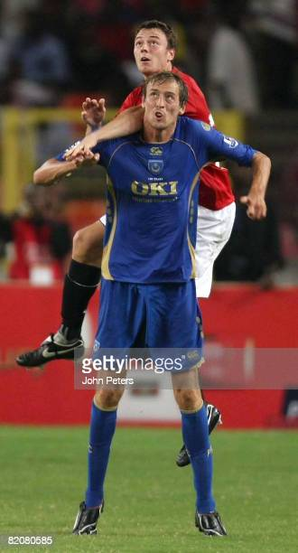 Jonny Evans of Manchester United clashes with Peter Crouch of Portsmouth during the preseason friendly match between Manchester United and Portsmouth...