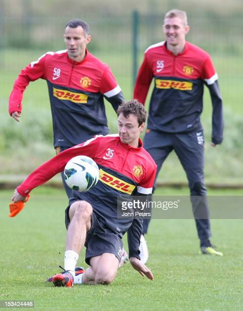 Jonny Evans of Manchester United in action during a first team training session at Carrington Training Ground on October 5, 2012 in Manchester,...