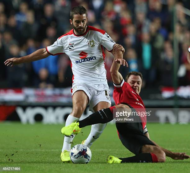 Jonny Evans of Manchester United in action with Will Grigg of MK Dons during the Capital One Cup Second Round match between MK Dons and Manchester...