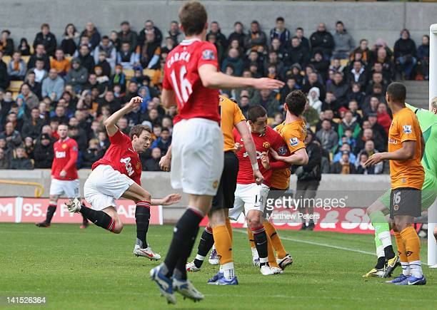 Jonny Evans of Manchester United scores their first goal during the Barclays Premier League match between Wolverhampton Wanderers and Manchester...