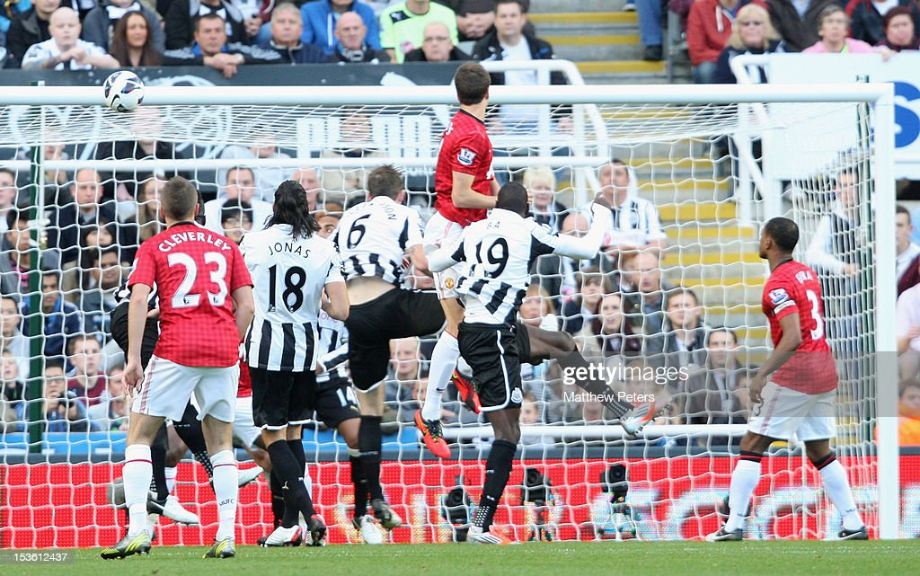 Jonny Evans of Manchester United scores their first goal during the Barclays Premier League match between Newcastle United and Manchester United at Sports Direct Arena on October 7, 2012 in Newcastle upon Tyne, England.