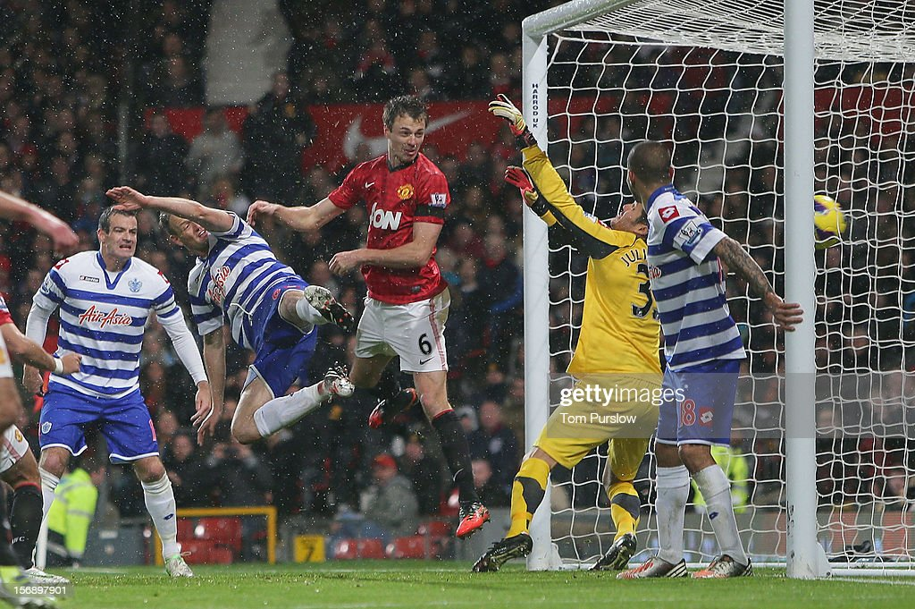 Jonny Evans of Manchester United scores their first goal during the Barclays Premier League match between Manchester United and Queens Park Rangers at Old Trafford on November 24, 2012 in Manchester, England.