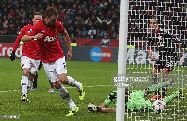 Jonny Evans of Manchester United scores their third goal during the UEFA Champions League Group A match between Bayer Leverkusen and Manchester...