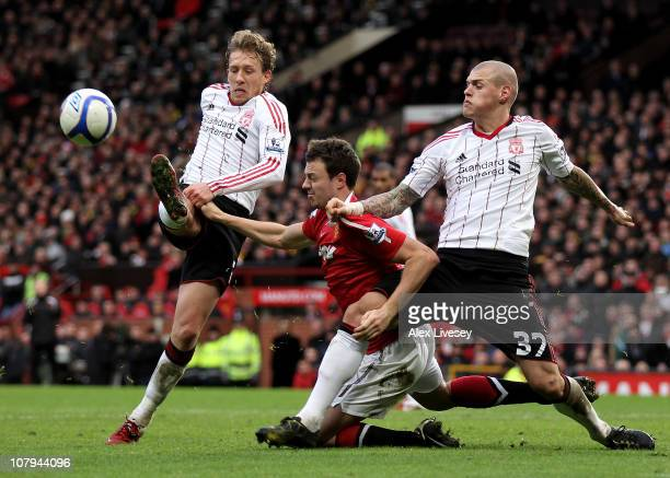 Jonny Evans of Manchester United tangles with Martin Skrtel of Liverpool in the penalty area during the FA Cup sponsored by E.ON 3rd round match...