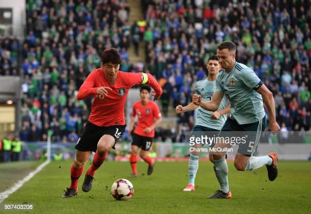 Jonny Evans of Northern Ireland and Sungyueng Ki of South Korea during the international friendly match between Northern Ireland and South Korea at...