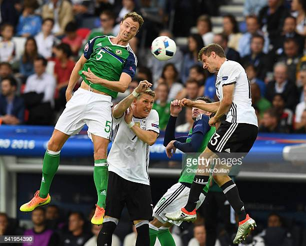Jonny Evans of Northern Ireland and Thomas Muller of Germany during the UEFA EURO 2016 Group C match between Northern Ireland and Germany at Parc des...